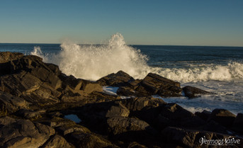 Wave Crashing into Rocks