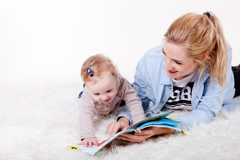 Mother reading to her baby