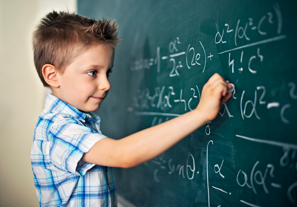 Kid solving difficult mathematical problems