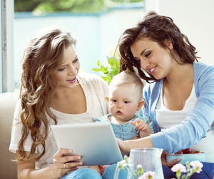 Mother showing flashcards to friend and daughter
