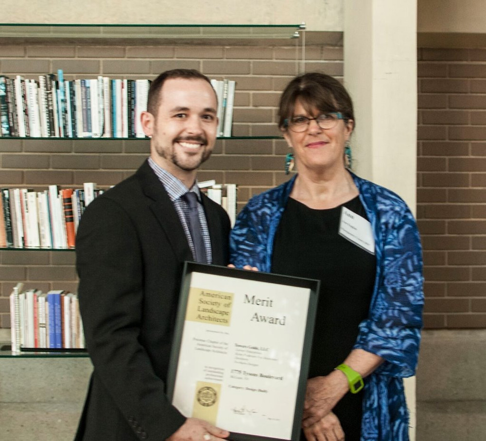 Shown: Sean Ragan, Towers|Golde Associate accepting award from Susan Newman,