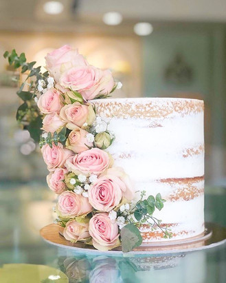 Simple naked cake with cascading baby bl