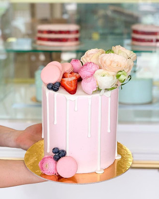 Beautiful blush pink drip cake with maca