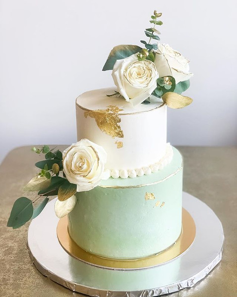A beautiful two tiered cake in our signa