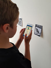 child playing a mobile game