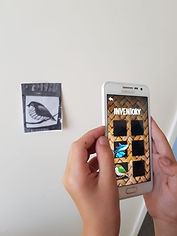 mobile phone showing mobile augmented realtiy game