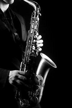 depositphotos_60280131-stock-photo-saxophone-player-saxophonist-with-sax_edited.jpg