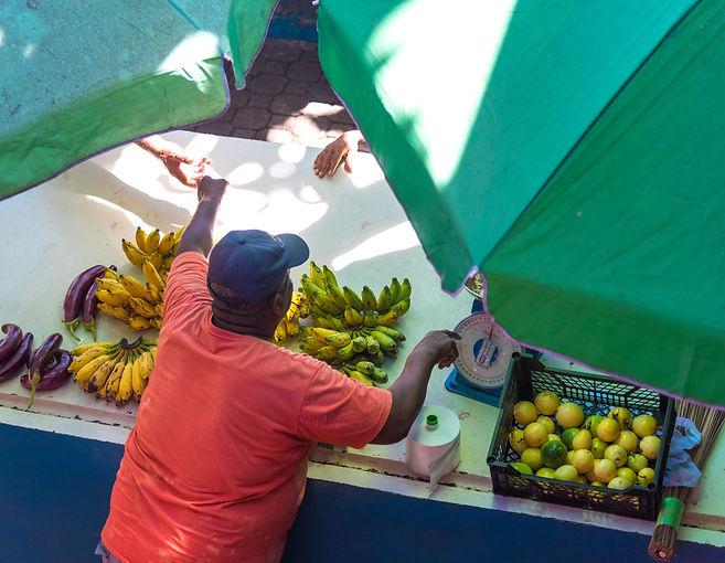 Seychellois man selling friut and veg