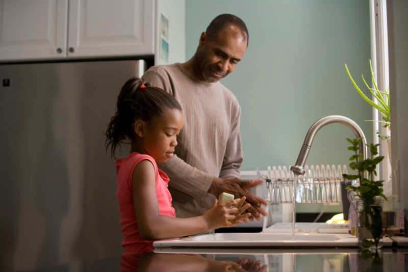 father daughter criticism trying to help at sink
