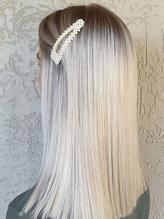 Stunning bright blonde with a subtle roo