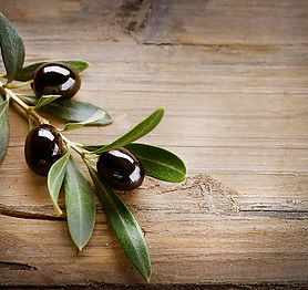 Olives on Wood Background