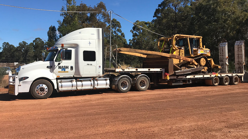 D6T Cat Dozer on Cat Prime Mover & Tri Axel Float