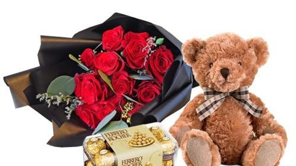 12 Red Roses in a bouquet, 16 Pcs Ferrero Rocher And Free Teddy Bear