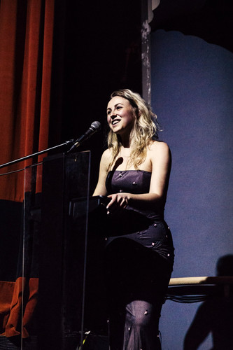 Paige Locke welcoming 250+ guests to the first private screening of 'Misfit M.' and '8+ Weeks' at The Royal, Toronto ON
