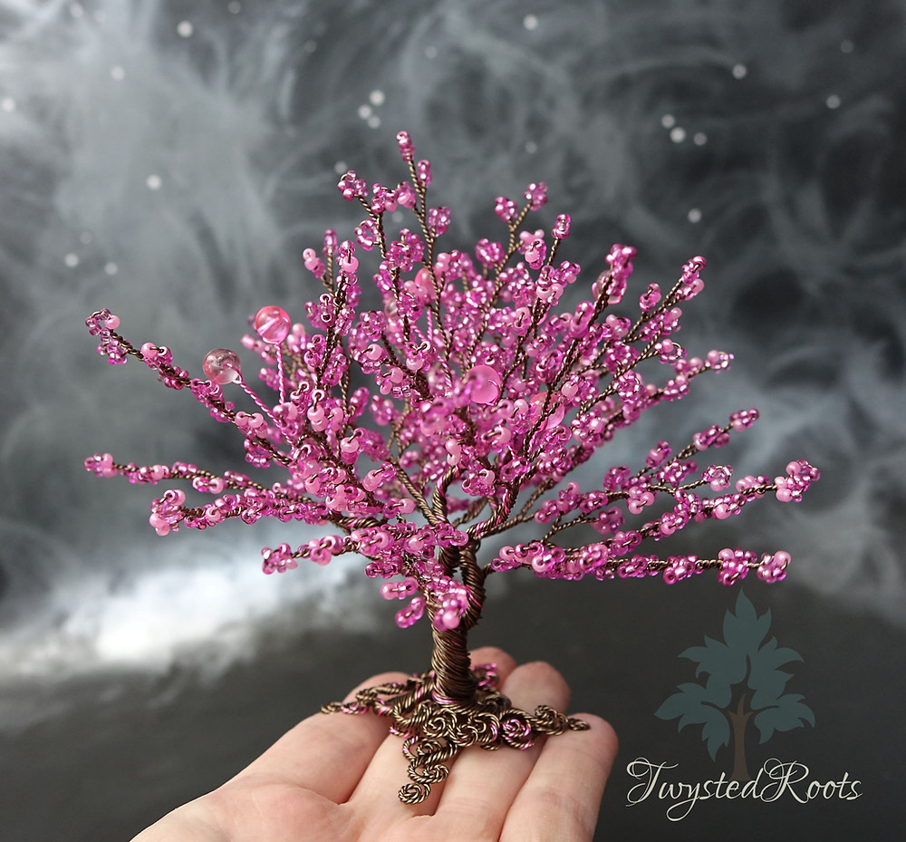 Bright pink bead and wire tree sculpture by Twysted Roots