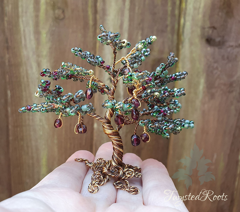 Green and garnet bead and wrie tree sculpture by Twysted Roots