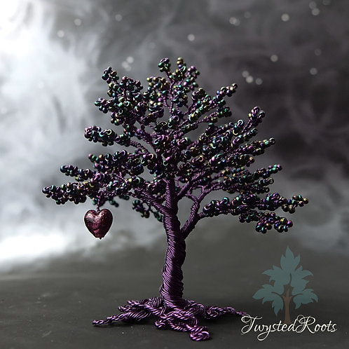 Dark purple bead and wire tree sculpture with a purple Murano glass heart