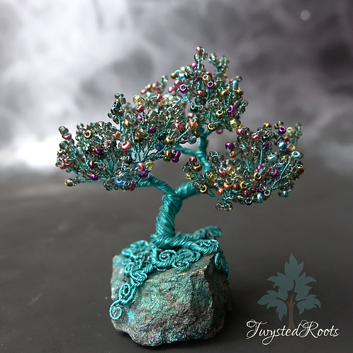 Happy Little Tree; wire tree sculpture on a peacock ore base