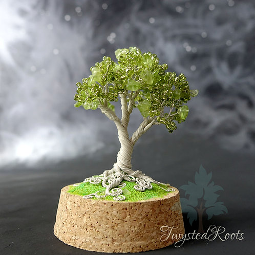 Peridot and light green bead and ivory coloured wire tree sculpture on a cork base