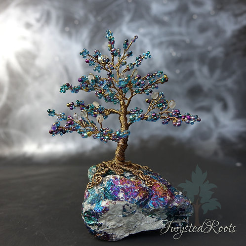Blue and antique bronze bead and wire tree sculpture on a peacock ore base