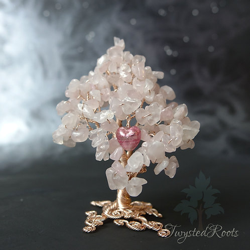 Rose quartz wire tree sculpture with a pink Murano glass heart by Twysted Roots
