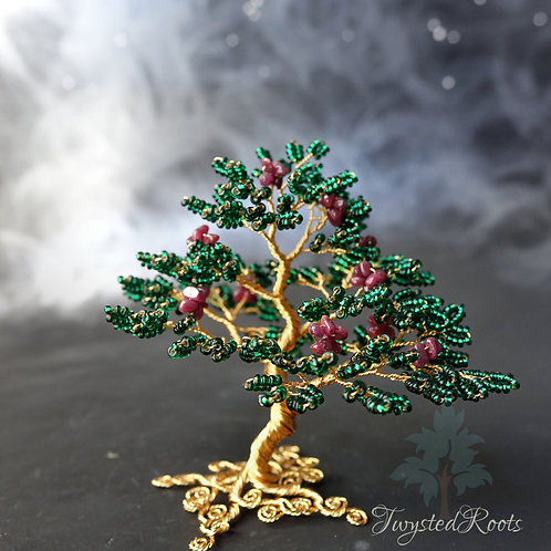 Deep green seed bead and ruby gemstone wire tree by Twysted Roots