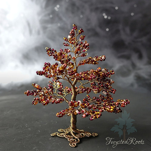 Deep red and antique bronze coloured bead and wire tree by Twysted roots