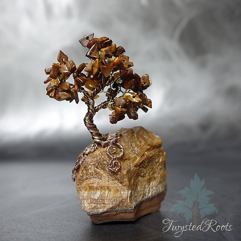 Miniature tiger eye gemstone wire tree sculpture on a tiger eye base