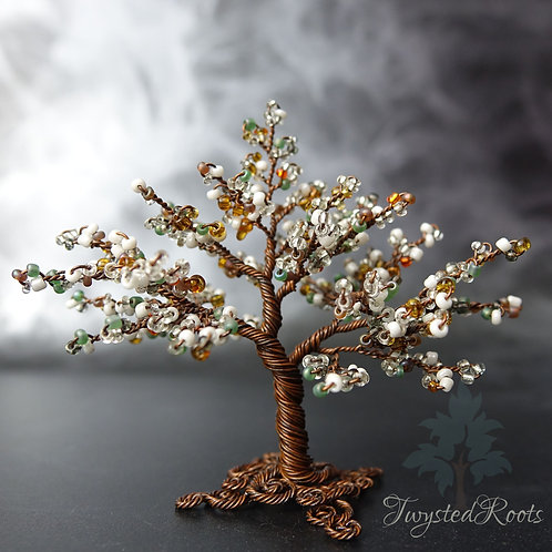 Bead and wire tree sculpture in earthy tones