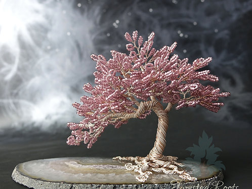 Pink bead and ivory coloured wire tree sculpture on an agate slice base