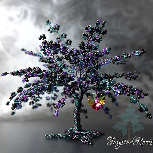 Black, purple and teal bead and wire tree sculpture with a rainbow coloured Swarovski crystal heart