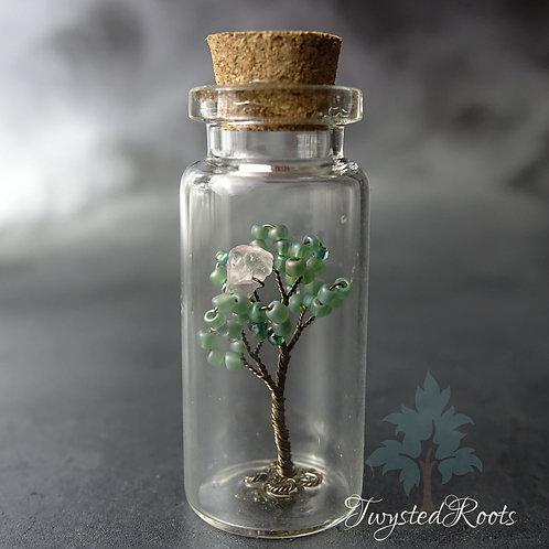 Rose Quartz tree seedling in a glass bottle
