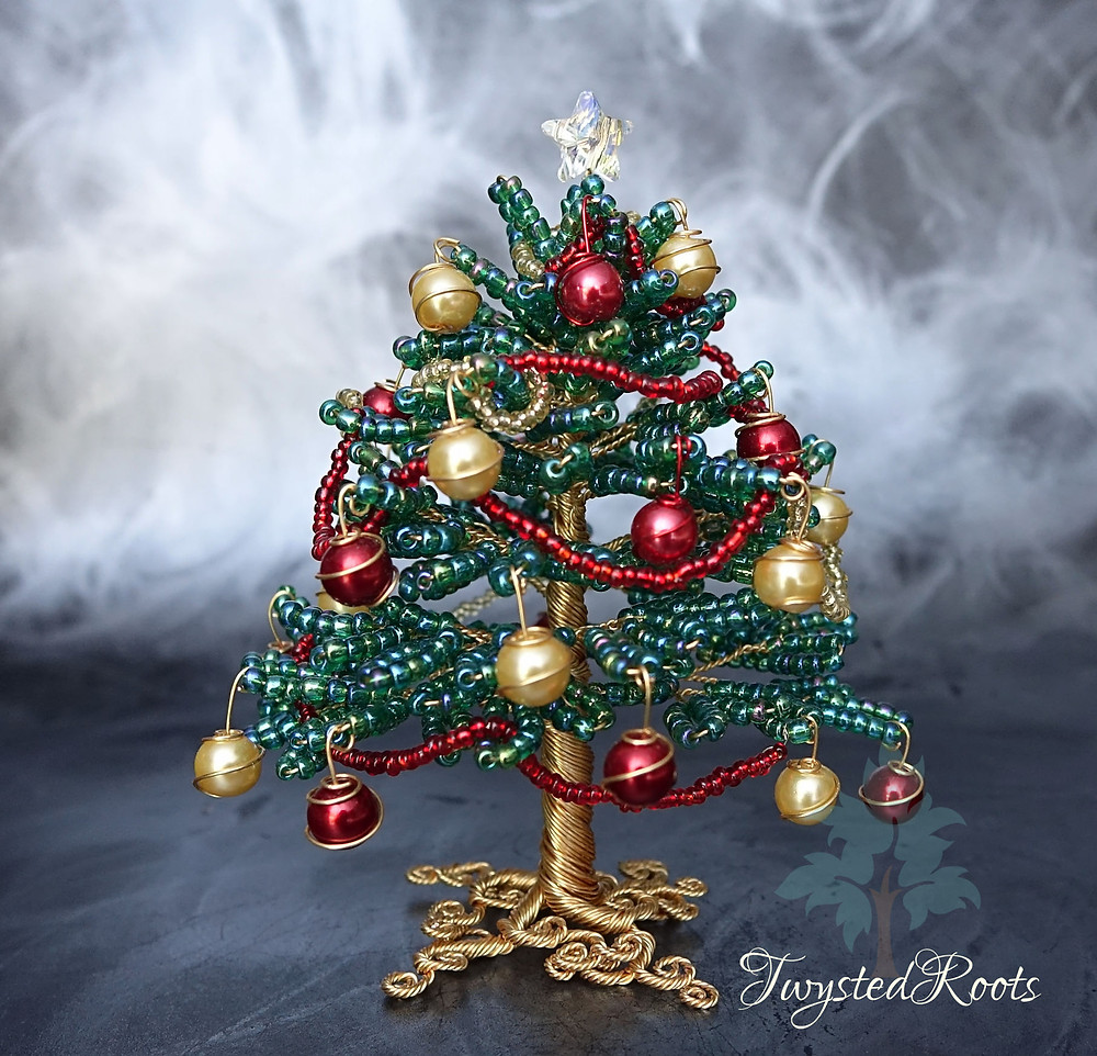 Bead and wire Christmas tree sculpture in green, gold and red with a Swarovski crystal star on top.