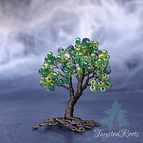 Miniature sapphire and green bead wire tree sculpture
