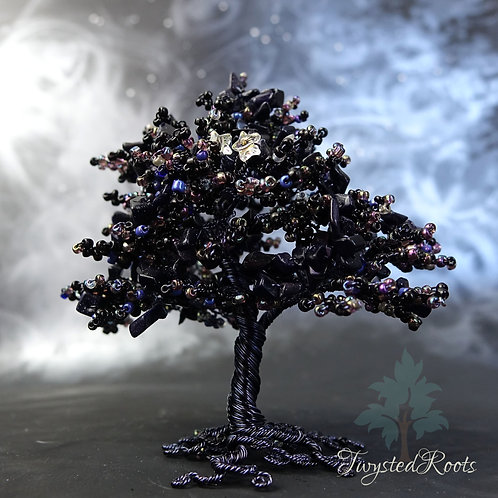 Black and blue goldstone bead and wire tree sculptures with two Swarovski stars