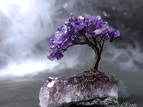 Amethyst gemstone wire tree sculpture on an amethyst base by Twysted Roots