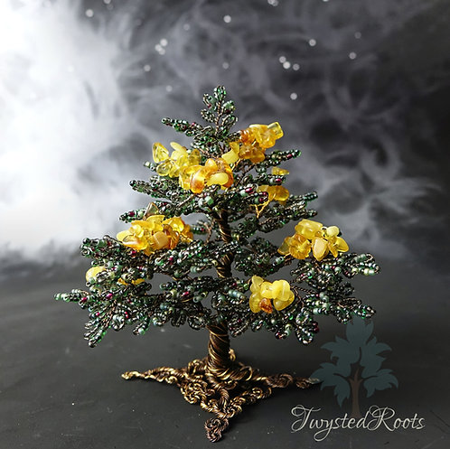 Dark green and amber bead and wire tree sculpture by Twysted Roots