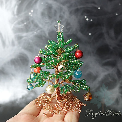 Green bead and copper wire Christmas tree with a clear star on top