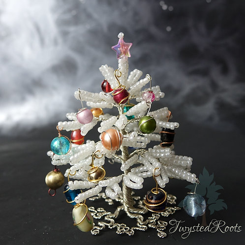 Bead and wire Christmas tree with a pink star on top
