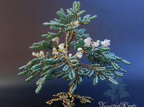 Green and opal bead and wire tree sculpture by Twysted Roots