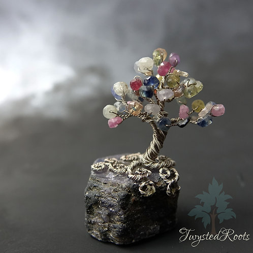 Miniature multicoloured sapphire gemstone tree sculpture on a sapphire base