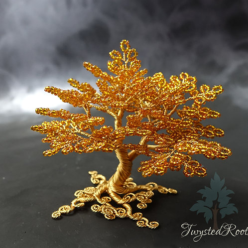 Orange bead and gold coloured wire tree sculpture by Twysted Roots