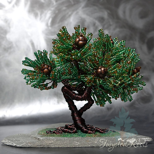 Pine effect bead and wire tree sculpture on a slate base