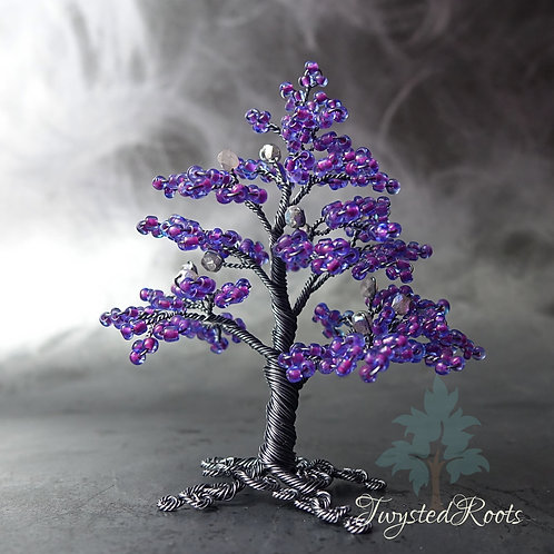 Purple beaded tree sculpture with smoke coloured copper wire by Twysted Roots