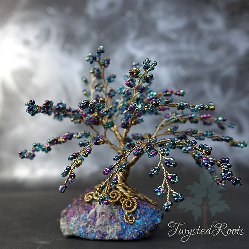 Blue weeping style bead and wire tree sculpture on a peacock ore base