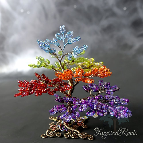 Rainbow coloured bead and wire tree sculpture by Twysted Roots