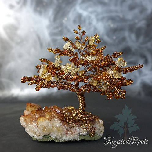 Amber coloured citrine and bead wire tree sculpture on a citrine crystal base