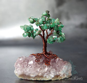 Miniature emerald on amethyst