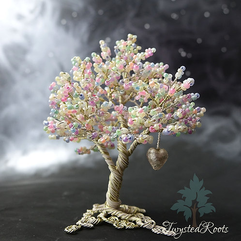 Pastel coloured bead and wire tree sculpture with a silver Murano glass heart