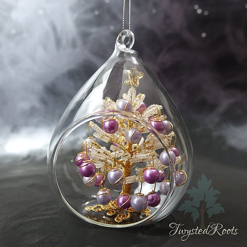White gold and light purple bead and wire Christmas tree in a teardrop shaped glass bauble